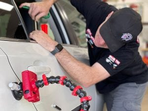 Ryan removing dents with PDR at Pro Auto Spa in Colorado Springs