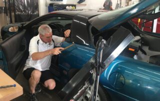 Ryan Smith doing Paintless Dent Repair at Pro Auto Spa in Colorado Springs