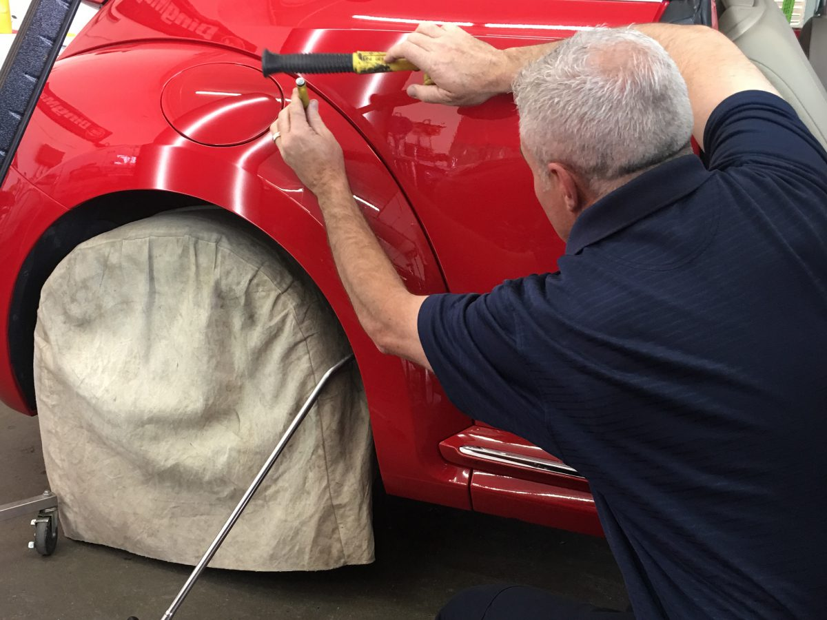 Ryan popping out a dent PDR at Pro Auto Spa in Colorado Springs