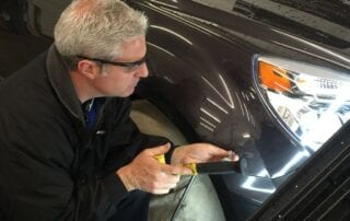 Ryan doing Paintless Dent Removal at Pro Auto Spa in Colorado Springs