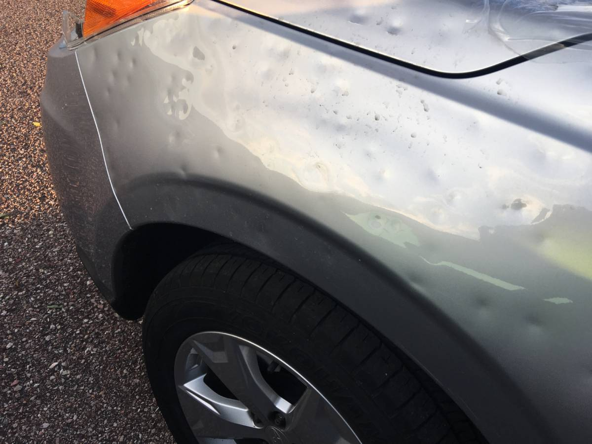 Hail Damage Repair Paintless Dent Removal at Pro Auto Spa in Colorado Springs