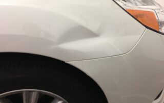 Paintless Dent Repair front quarter panel at Pro Auto Spa in Colorado Springs